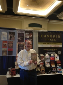 Cambria Press author Professor David K. Schneider with his new book at the Cambria Press AAS booth